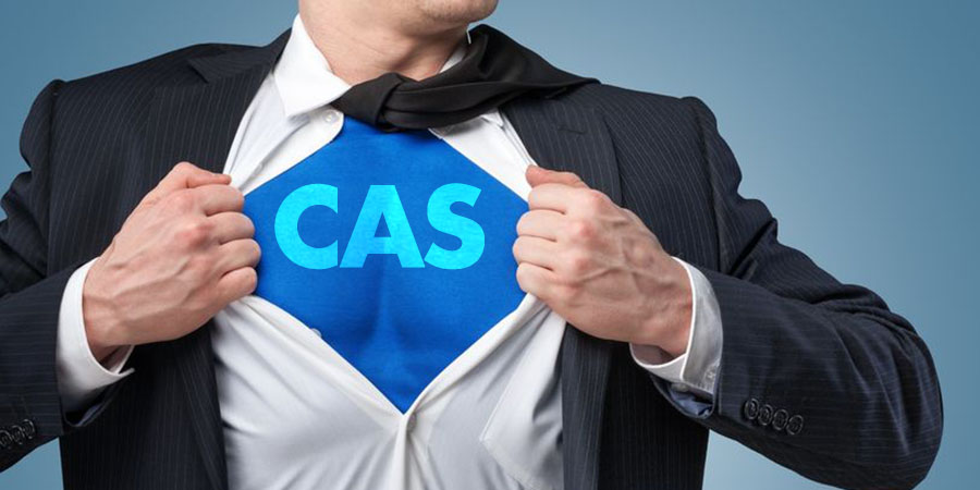 "Man opening shirt to reveal superhero costume with the words ""CAS"" on his chest."