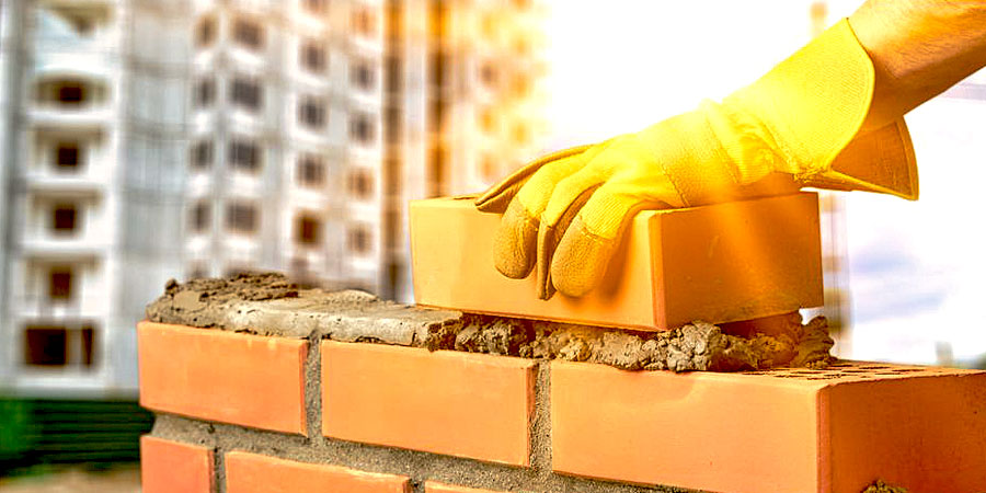 Someone laying bricks